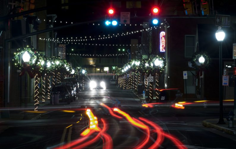 Car tail lights illuminate this scene onto Front Royal's Main Street with Christmas lights lining the streets.   Rich Cooley/Daily